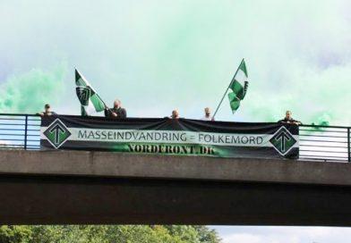 """Mass Immigration = Genocide"" Banner Drop in Denmark"
